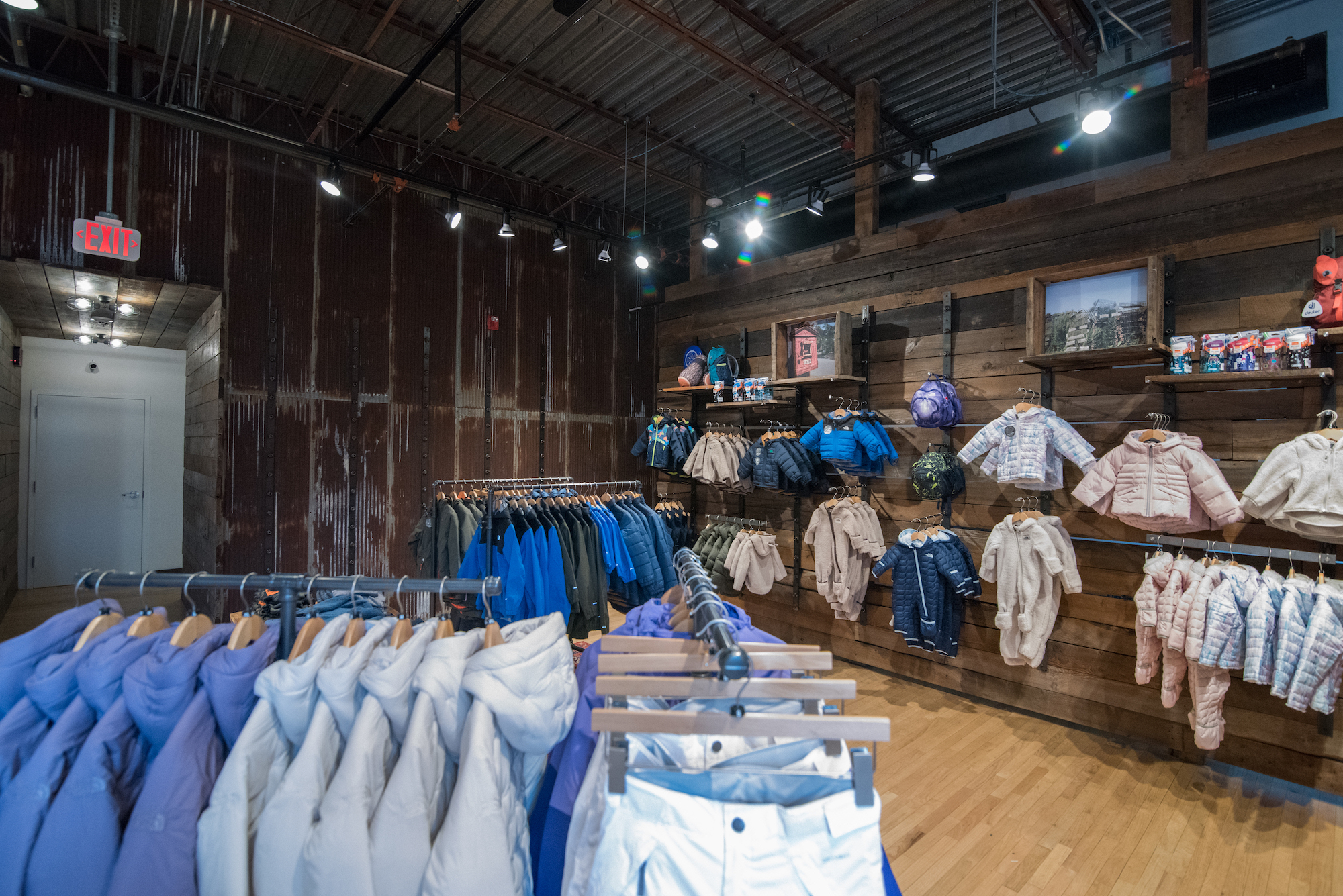 Outerwear retail store Denali in Providence, Rhode Island, featuring vintage wood sourced by Rousseau Reclaimed Lumber & Flooring
