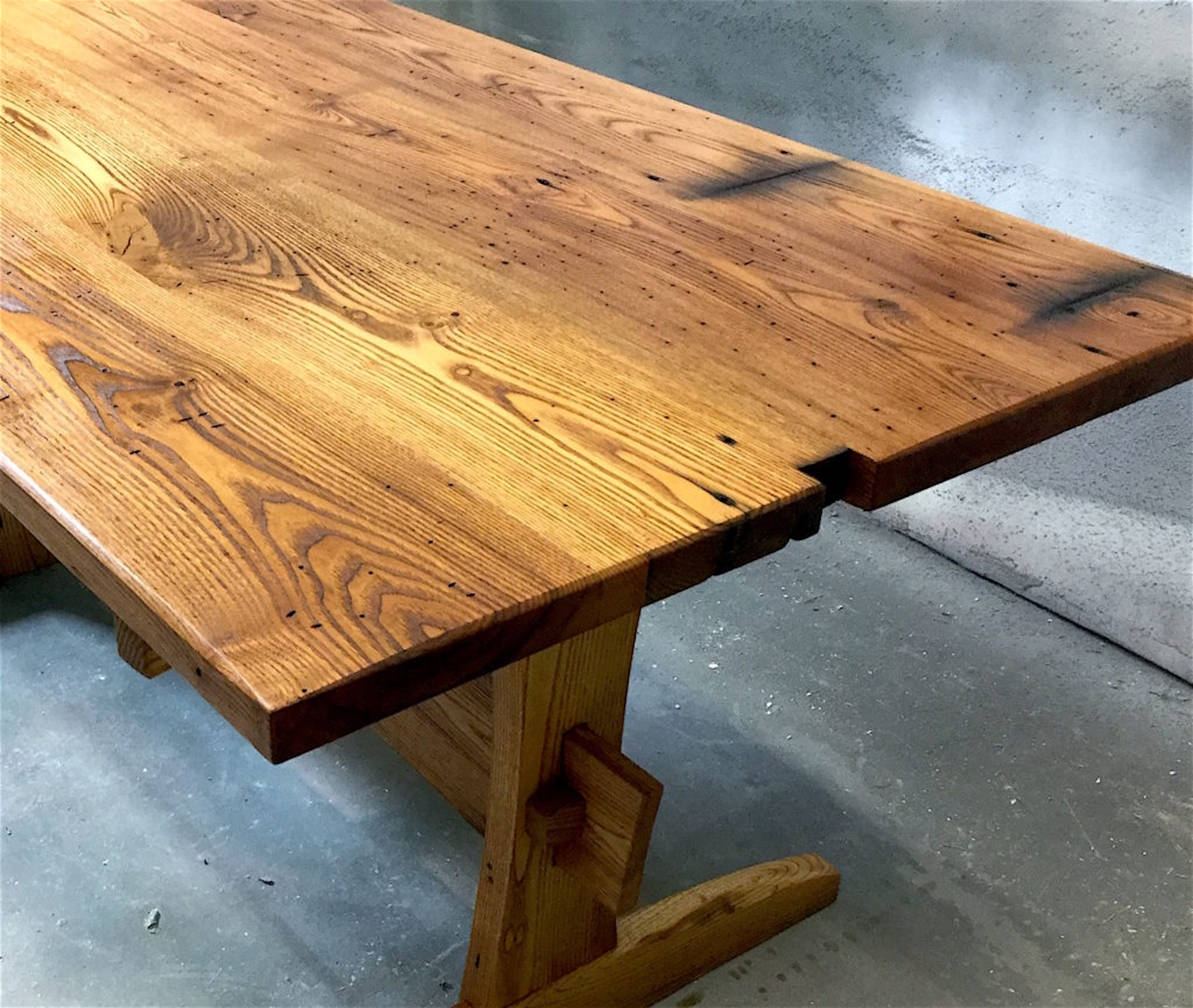 Trestle-style table made from reclaimed chestnut lumber sourced by Rousseau Reclaimed Lumber & Flooring in South Portland, Maine