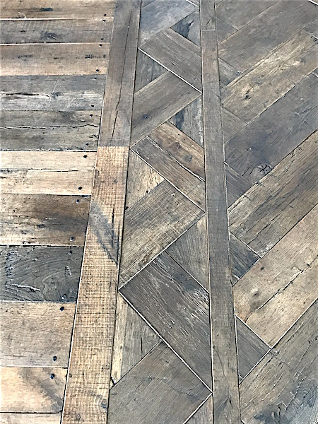 Detail of herringbone flooring made from reclaimed cotton mill oak in Pemaquid, Maine, sourced by Rousseau Reclaimed Lumber & Flooring