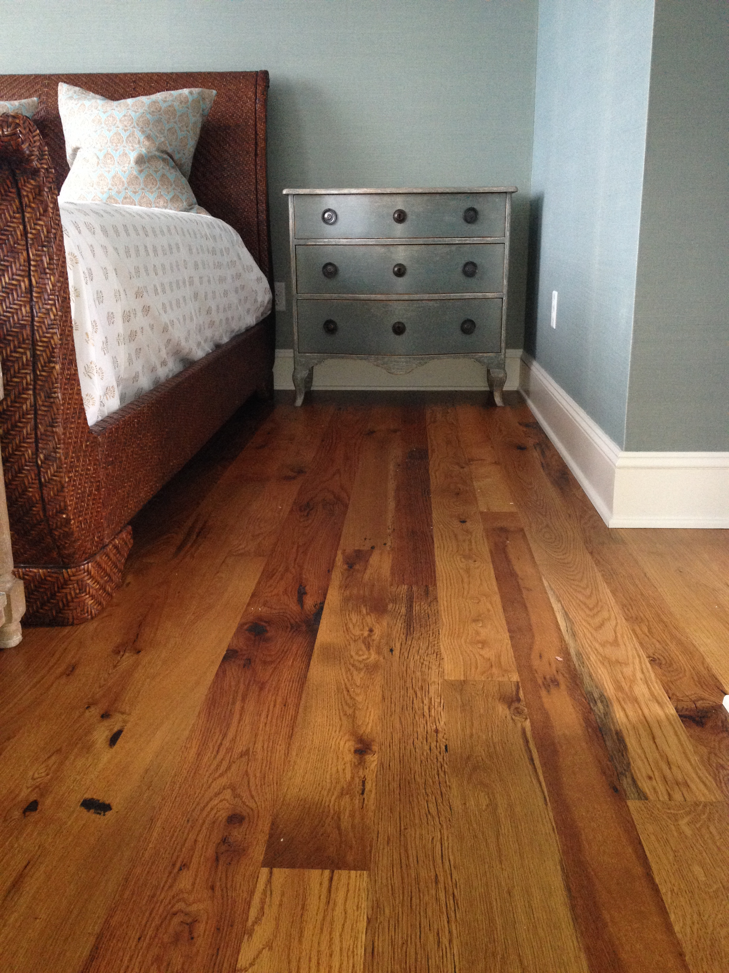 Bedrom with antique white floor in a residence in Kennebunkport, Maine