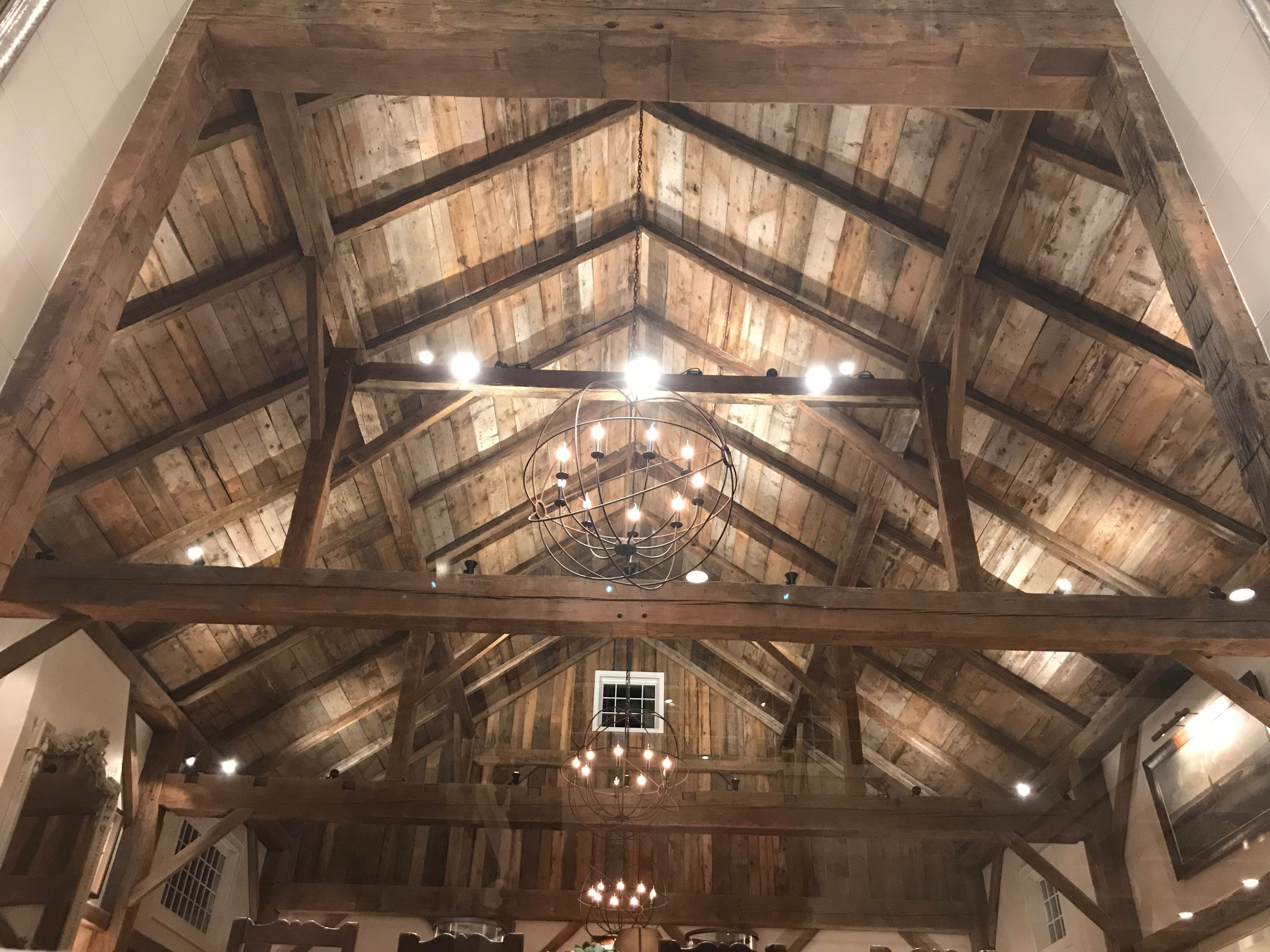 Cathedral ceiling made from reclaimed timbers in a residence in Pemaquid, Maine, sourced from Rousseau Reclaimed Lumber & Flooring
