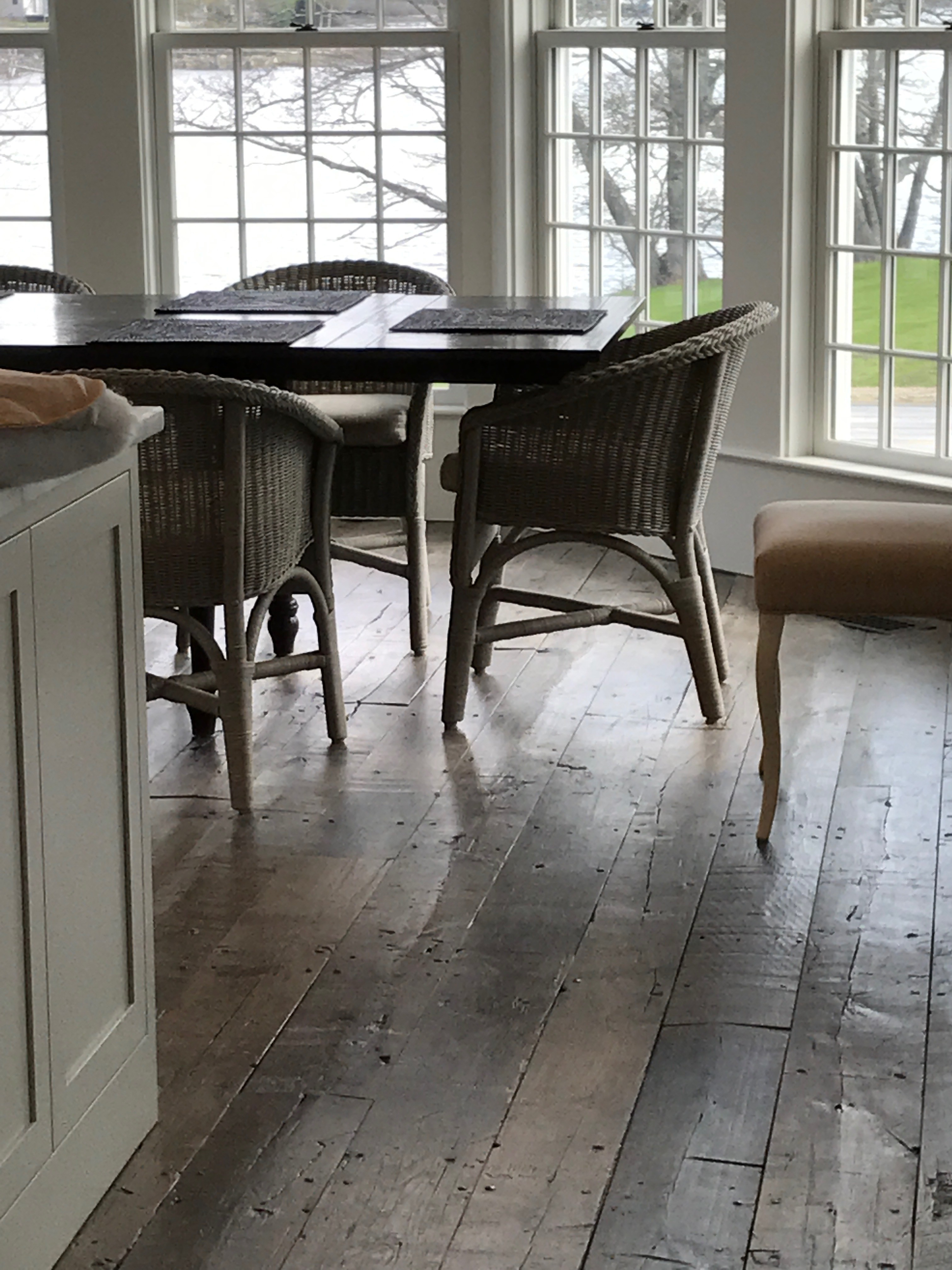 Dining room of a converted barn residence with reclaimed cotton mill oak flooring in Pemaquid, Maine