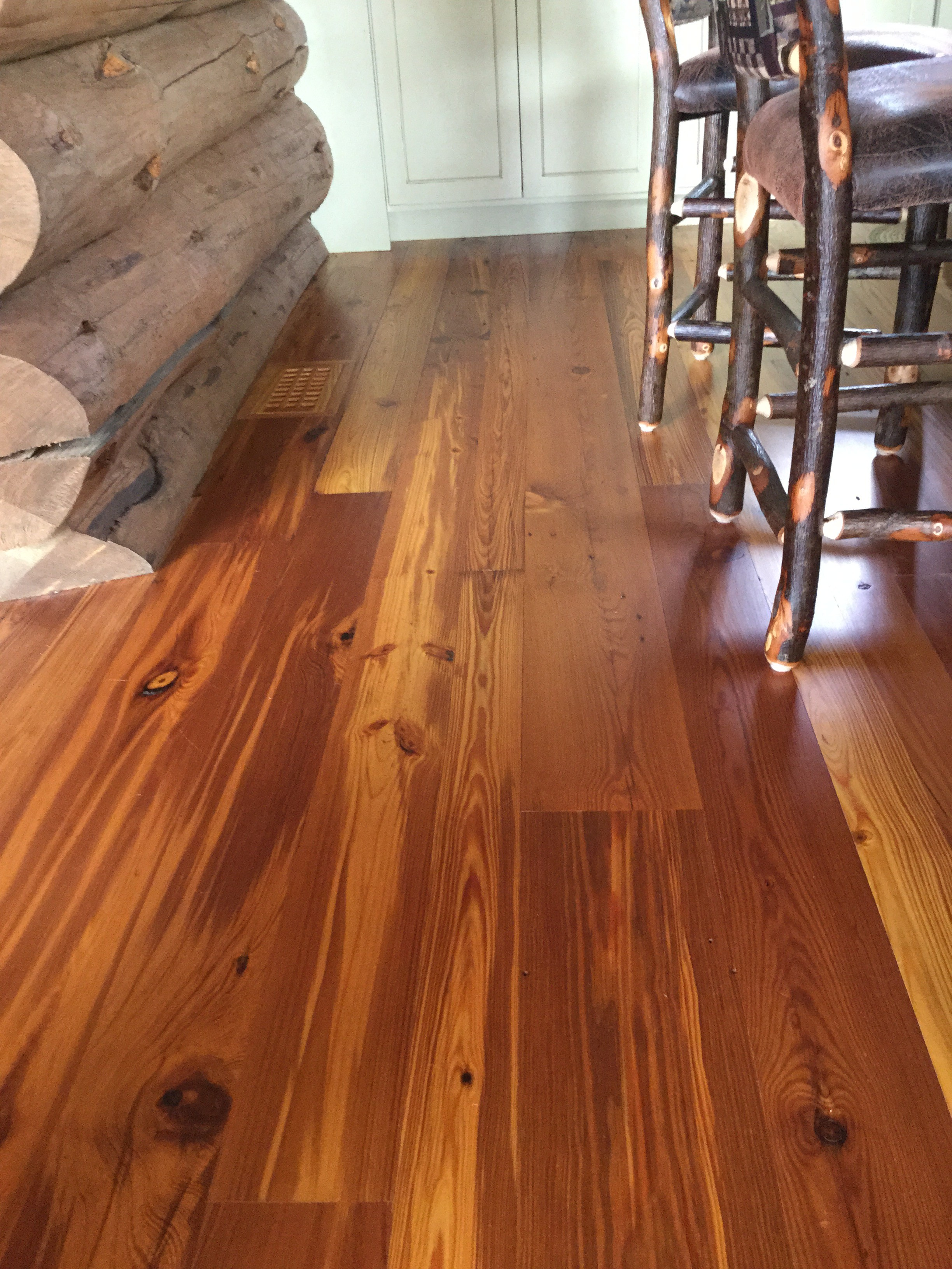 Reclaimed heart pine mill run floor in a residence in Newry, Maine sourced by Rousseau Reclaimed in South Portland, Maine