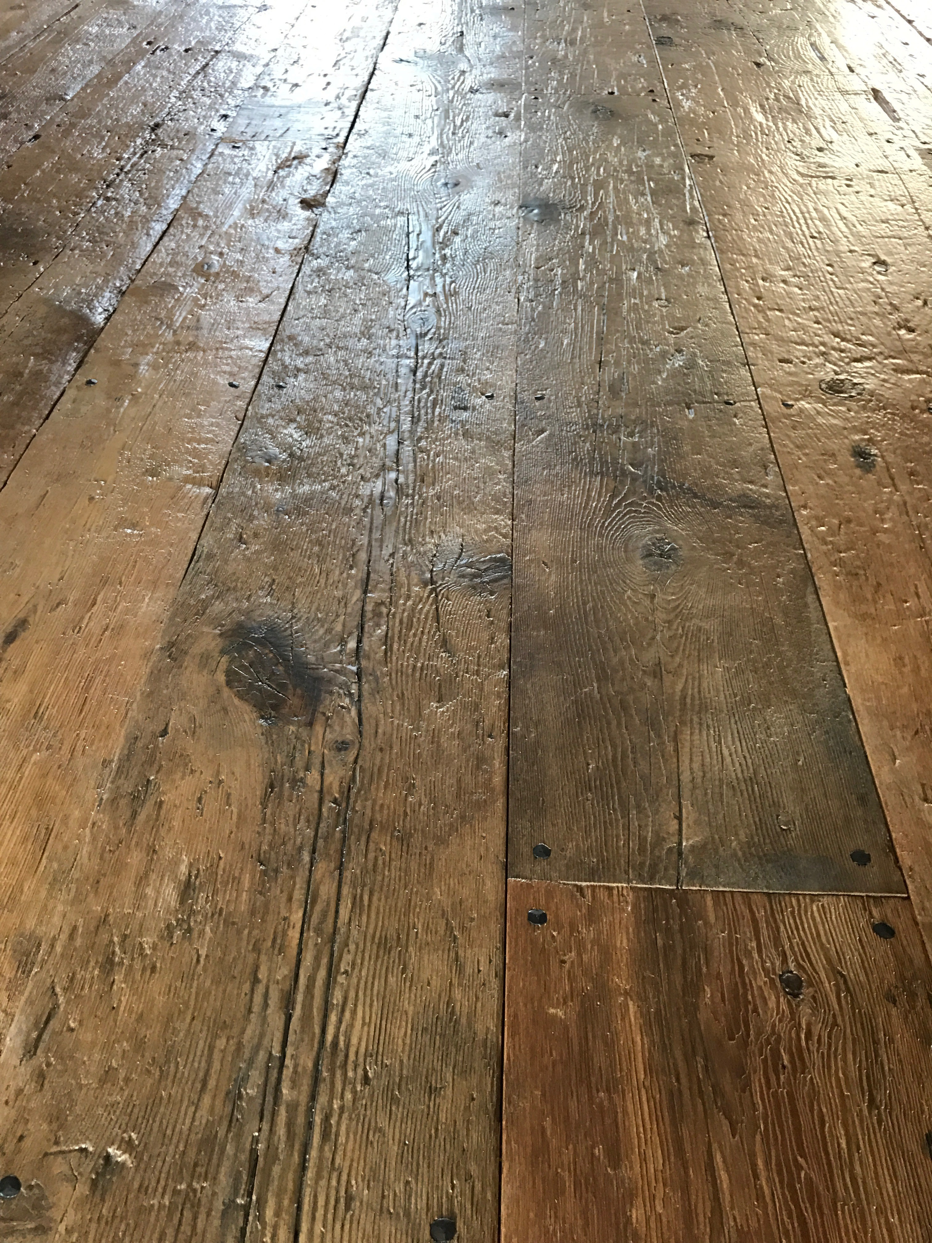 Detail of reclaimed original surface flooring in a residence in Pemaquid, Maine, sourced by Rousseau Reclaimed Lumber & Flooring