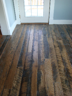 Hallway floor made from skip milled oak in a residence in Wolfeboro, Maine