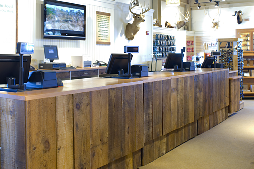 Retail counter in Freeport, Maine featuring barn board sourced by Rousseau Reclaimed Lumber & Flooring