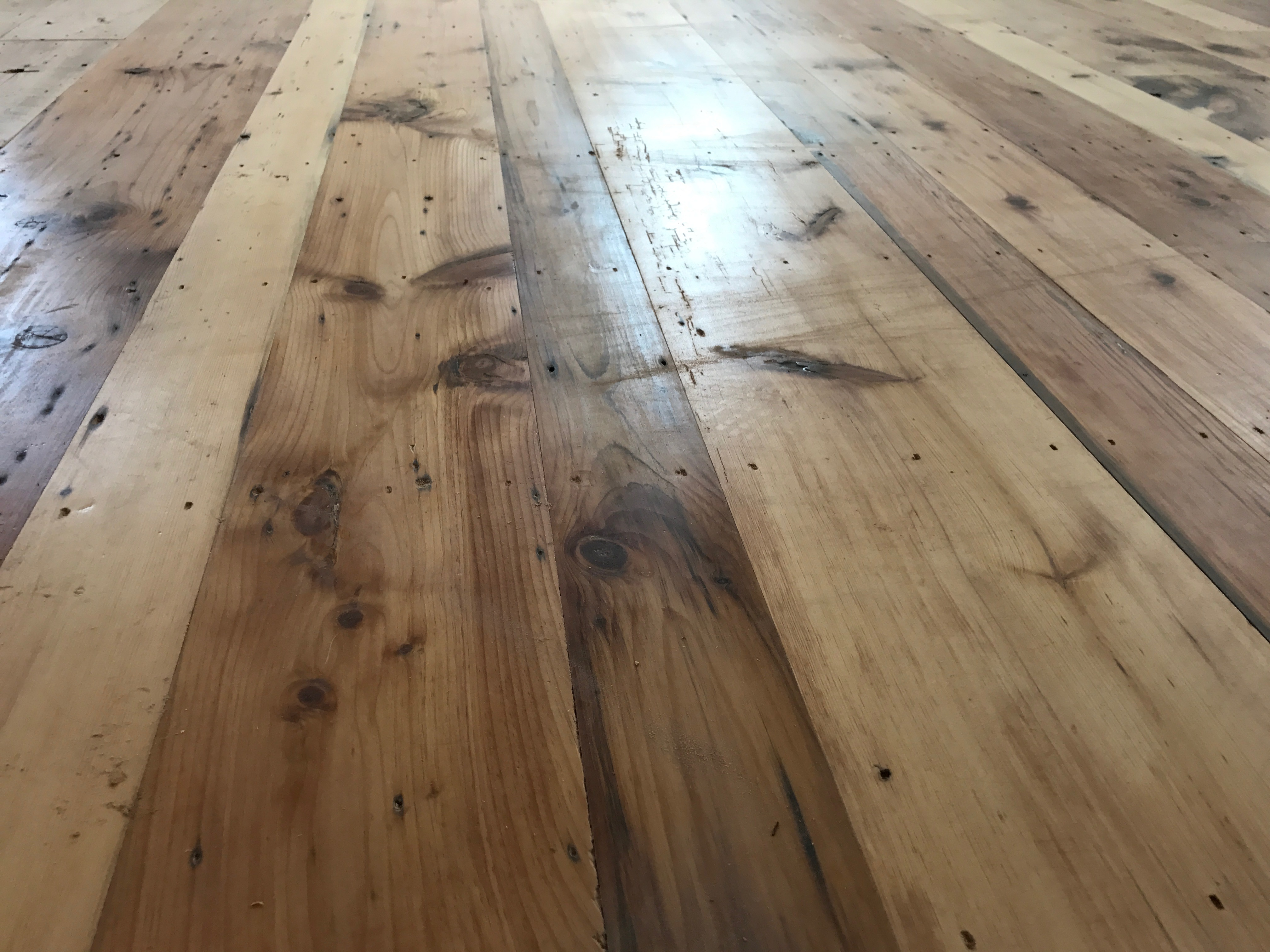 Antique pumpkin pine floor in a residence in Boothbay Harbor, Maine