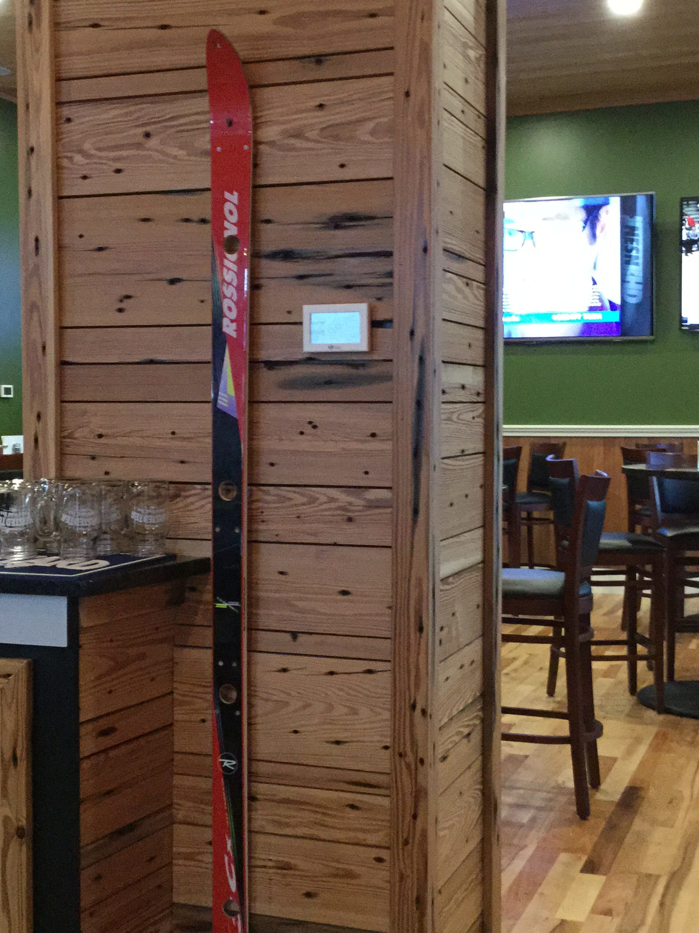Accent wall in a restaurant in Sunday River, Maine featuring wood sourced by Rousseau Reclaimed Lumber & Flooring