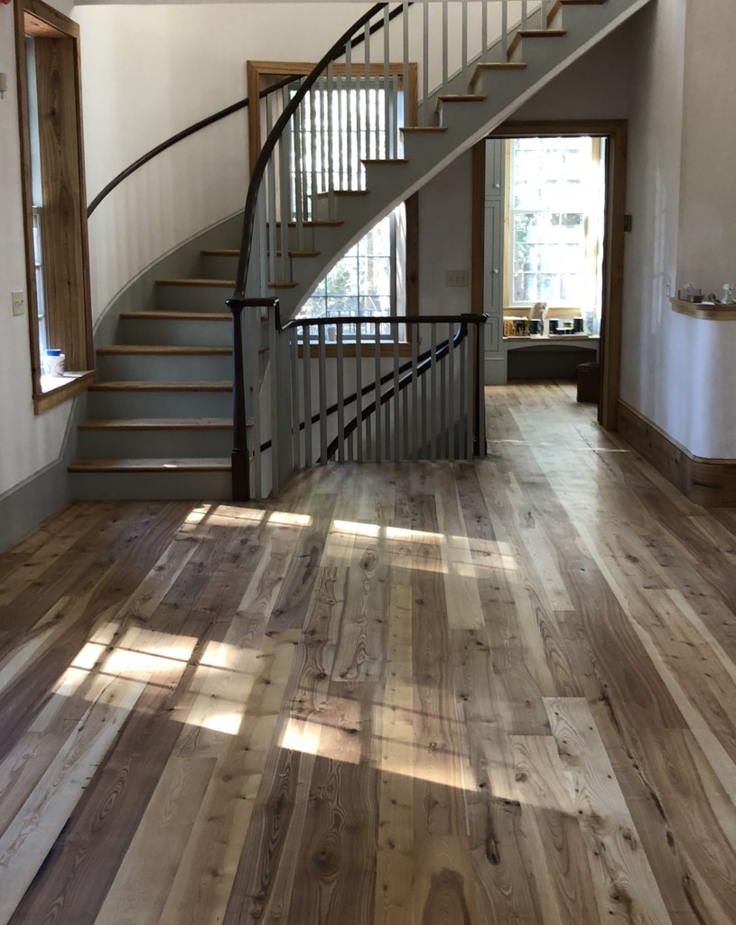 Residential flooring made from antique ash lumber in South Freeeport, Maine sourced by Rousseau Reclaimed Lumber & Flooring