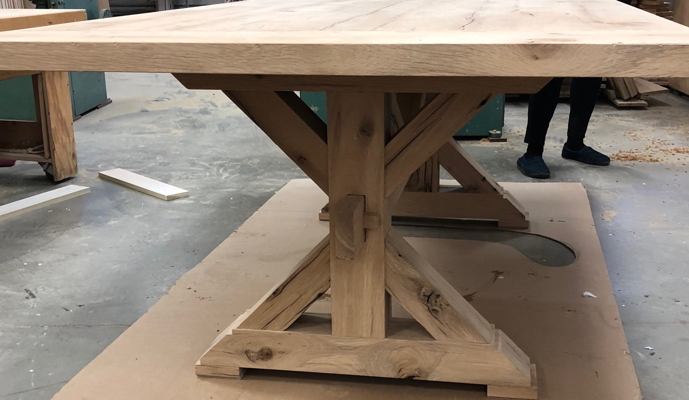 Trestle-style table made from antique white oak sourced from Rousseau Reclaimed Lumber & Flooring in South Portland, Maine