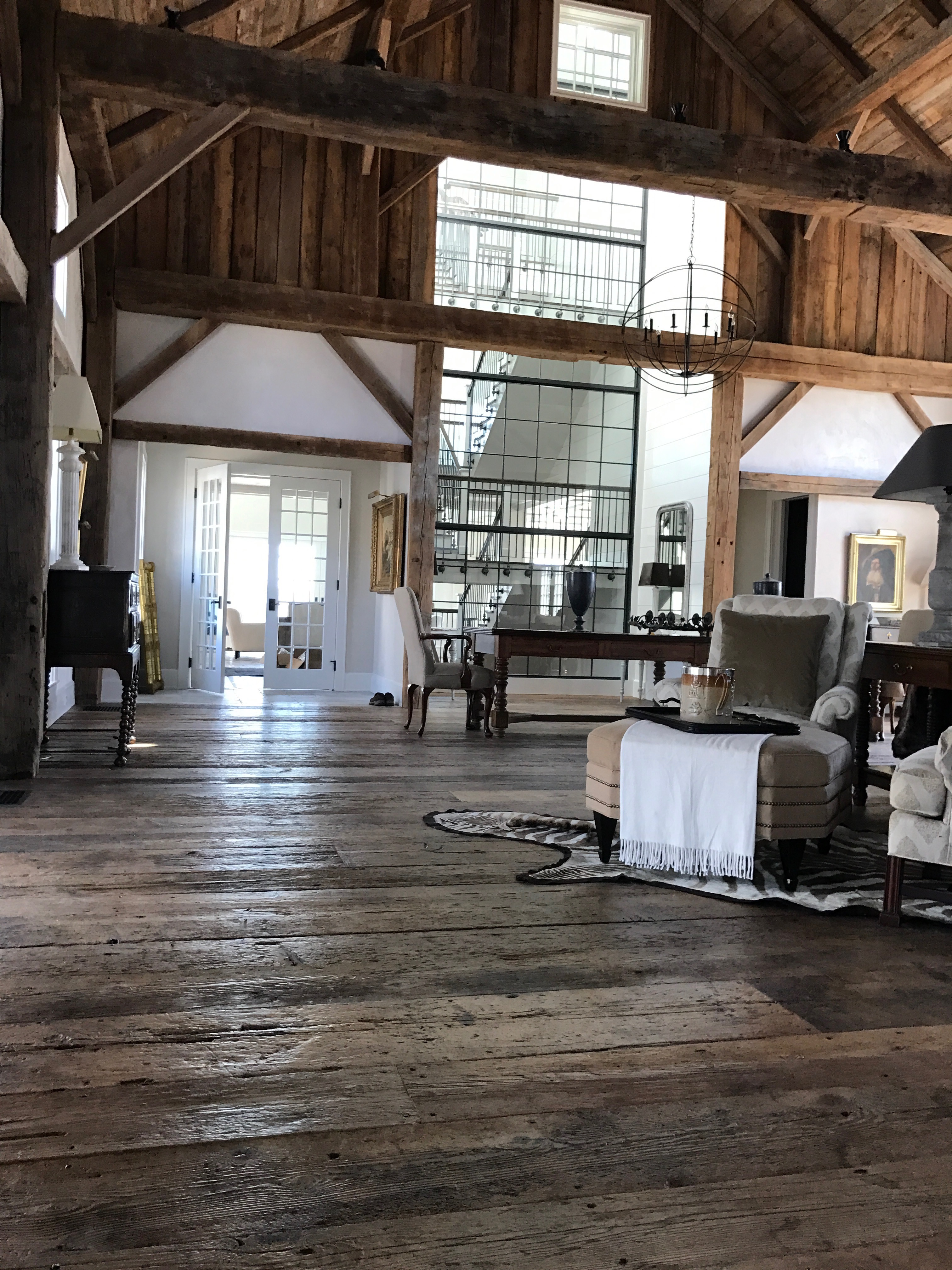 Reclaimed barn board flooring and timbers in a converted barn residence in Pemaquid, Maine
