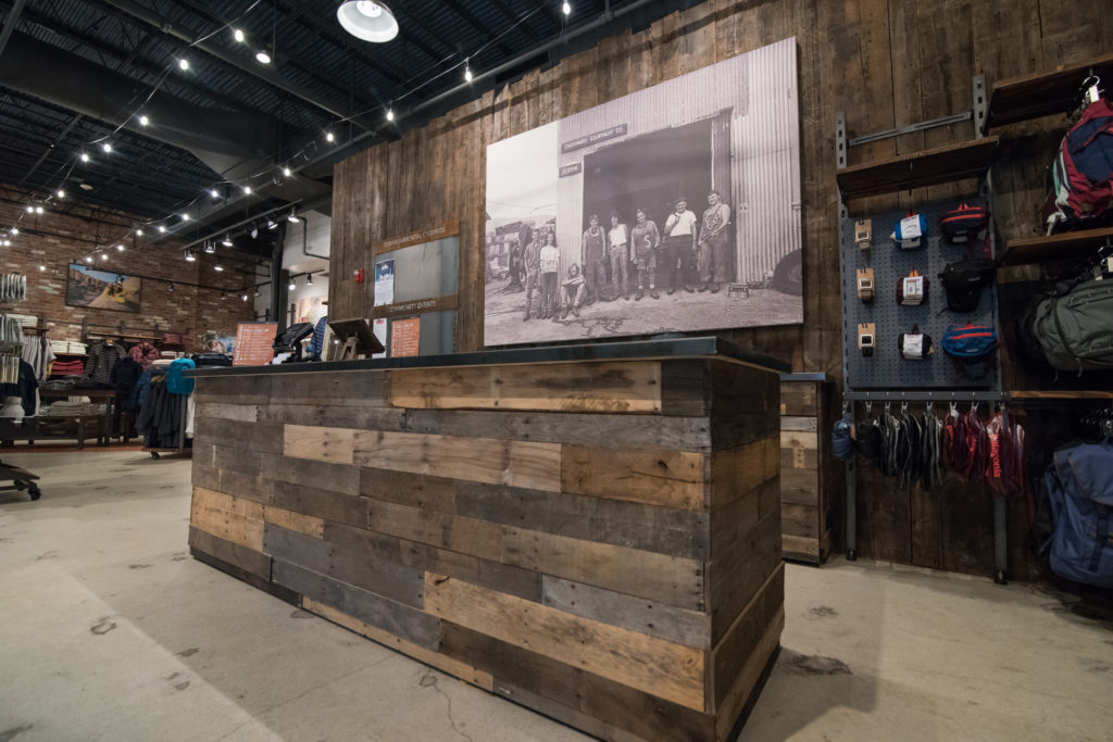 Cash wrap made from reclaimed barn board at Denali store in Providence, Rhode Island, sourced by Rousseau Reclaimed Lumber & Flooring
