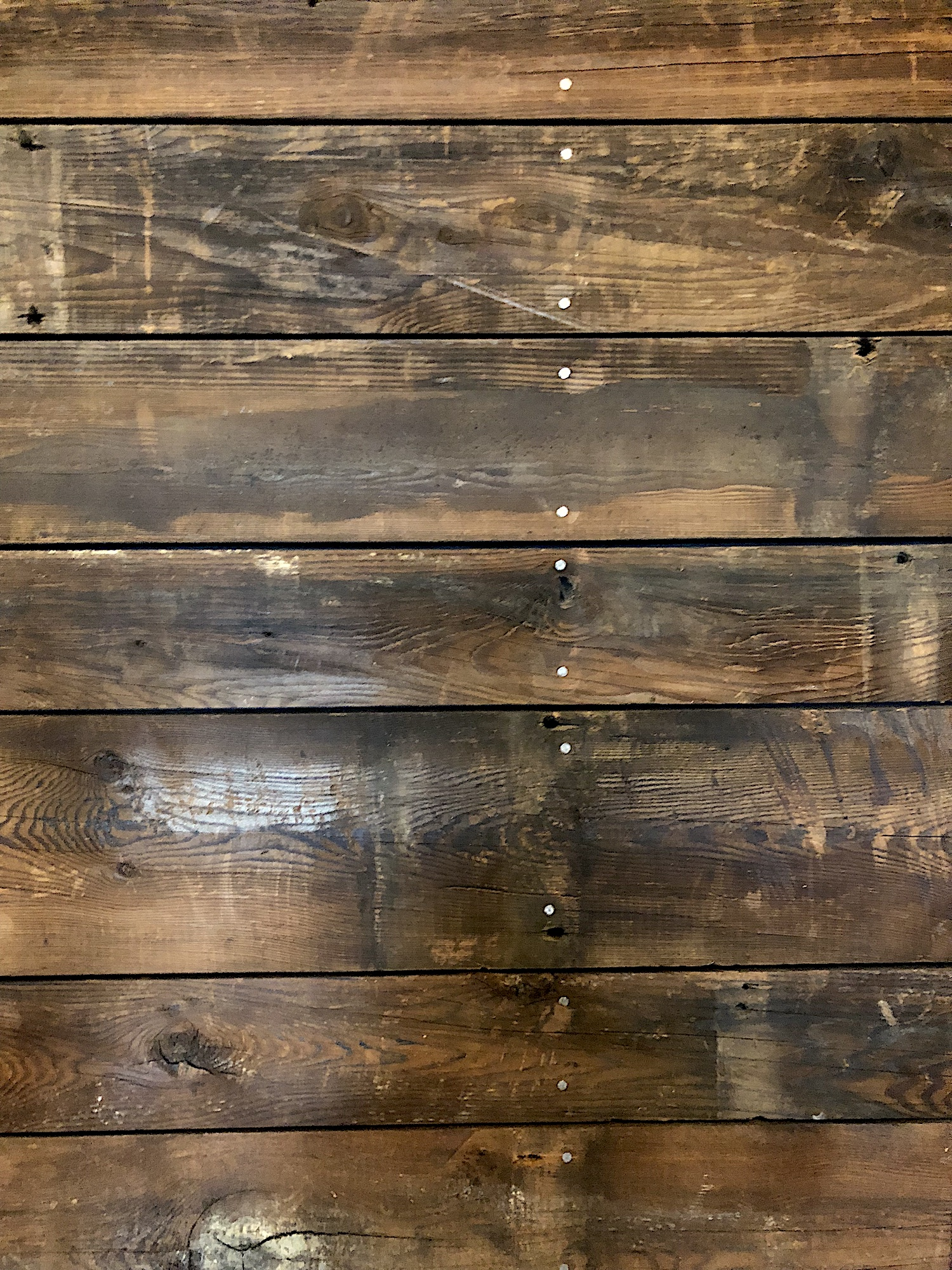 Detail of reclaimed barn board wall in a converted barn playhouse in Edgecomb, Maine, sourced by Rousseau Reclaimed Lumber & Flooring