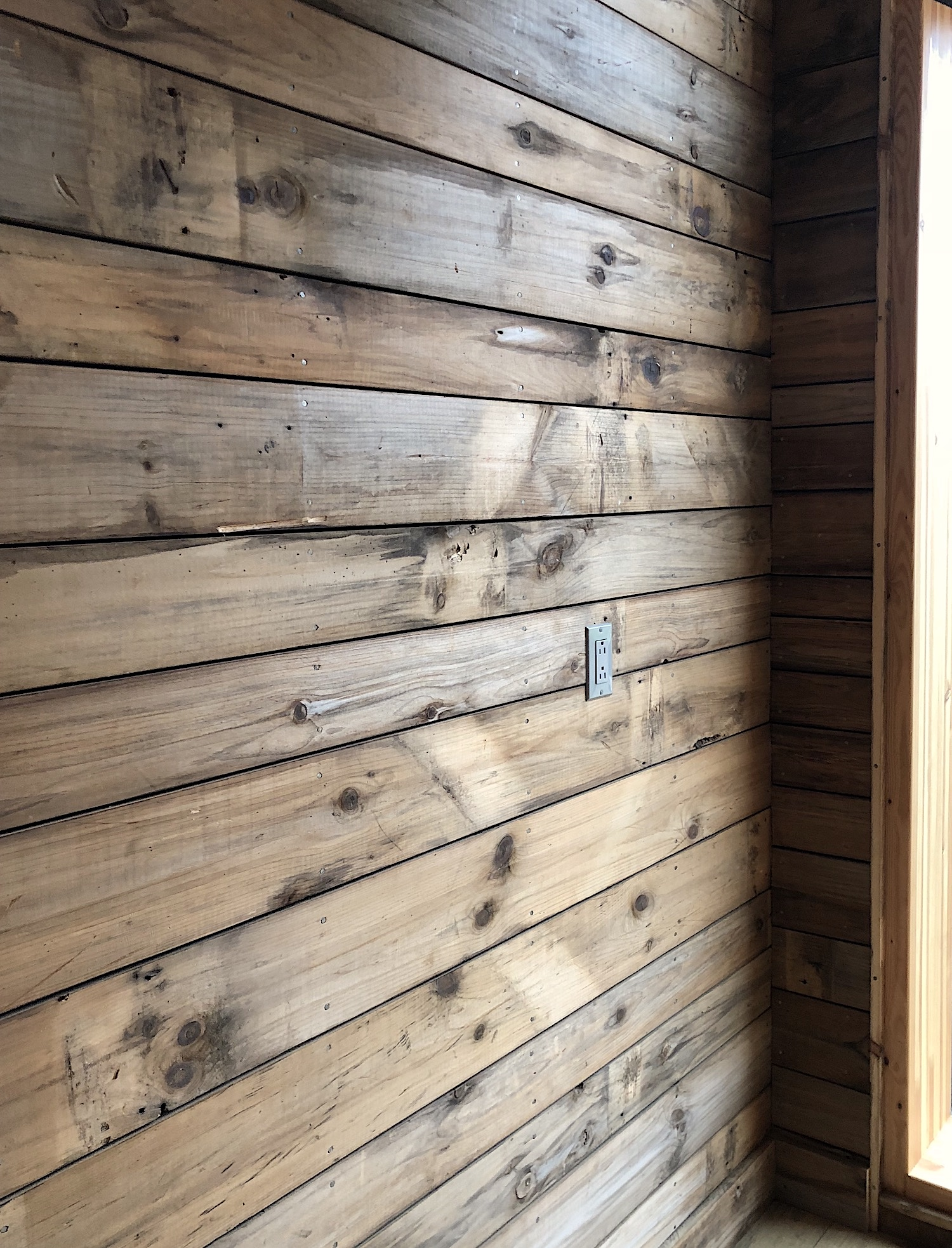 Reclaimed barn board wall in converted barn playhouse in Edgecomb, Maine, sourced by Rousseau Reclaimed Lumber & Flooring