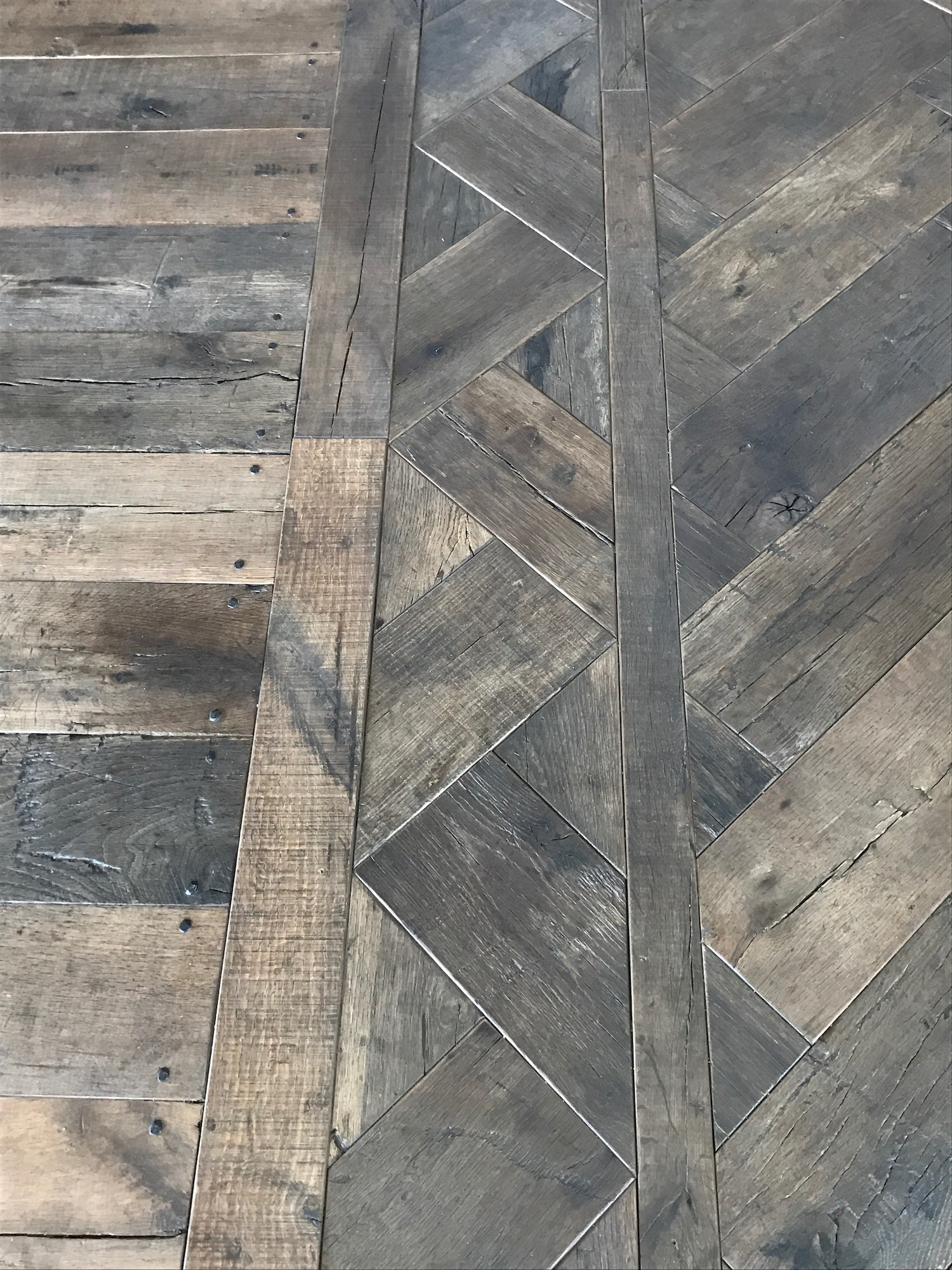Detail of herringbone flooring made from reclaimed cotton mill oak in a residence in Pemaquid, Maine, sourced by Rousseau Reclaimed Lumber & Flooring