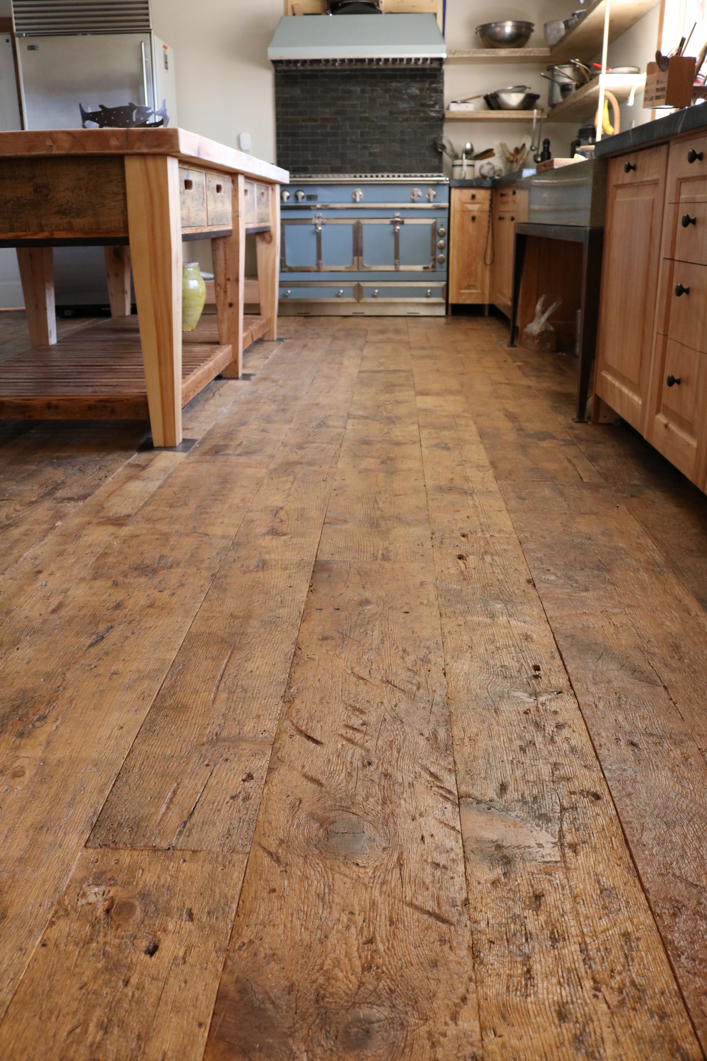Residential kitchen floor made from reclaimed barn board in Yarmouth, Maine