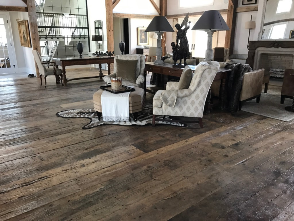 Spacious living room featuring original surface flooring made from reclaimed barn board in a residence in Pemaquid, Maine